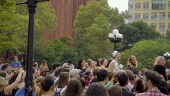 Rock band playing music Washington Square Park in summer crowd taking pictures Stock Footage