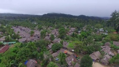 DRONE AERIAL FLYING OVER THAILAND BURMA MYANMAR REFUGEE CAMP SHELTER Stock Footage