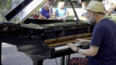 People watching piano music performance Washington Square Park summer day NYC 4K Stock Footage