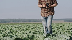 Man Taking Pictures of Cabbages with Digital Camera Stock Footage