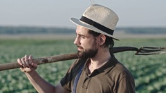 Portrait of Smiling Farmer with Pitchfork Stock Footage