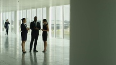 4K Business group in large open plan office, chatting & walking through building Stock Footage