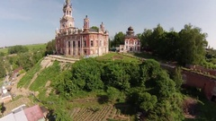 Nicholas orthodox church in the Gothic style on a hill in the city Mozhaisk, aer Stock Footage