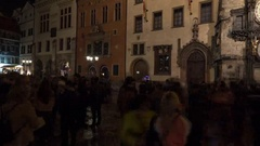 Timelapse of people near Prague astronomical clock at night Stock Footage