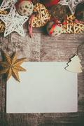 Christmas letter on wooden background with decorations arround Stock Photos
