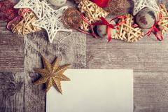 Christmas letter on wooden background with ornaments arround Stock Photos