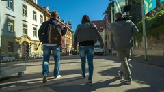 Team which is making a movie is walking on the street Stock Footage