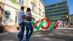 Taking a selfie in front of a 'wow' sign in Ljubljana Stock Footage