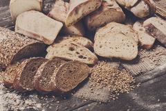 Bakery concept. Plenty of sliced bread background Stock Photos