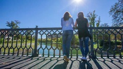 Leaning on the fence and observing the river Ljubljanica Stock Footage