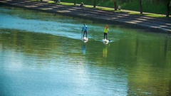 Two people are stand up paddling on the river Ljubljanica Stock Footage