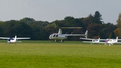 Helicopter hovering next to parked aeroplanes. Stock Footage