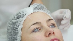 Doctor draw lines with marker on patient face for facial plastic surgery at Stock Footage
