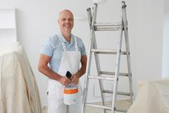 Portrait Of Decorator Painting Room Stock Photos