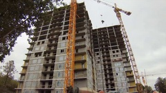 Construction, building construction on a background of gray sky. Stock Footage