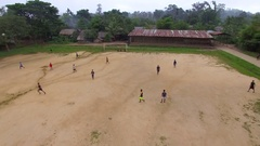 DRONE AERIAL THAILAND BURMA MYANMAR REFUGEE CAMP SHELTER PLAYING FOOTBALL SOCCER Stock Footage