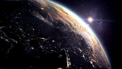 Beautiful Sunrise over the Earth. Cities at Night. Stock Footage