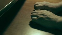 An older man tries to restore feeling to his numb hand Stock Footage