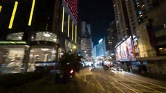 Timelapse of traveling through night Hong Kong by double-decker tram Stock Footage