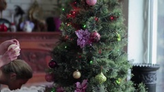 Beautiful girls decorating Christmas tree in home Stock Footage