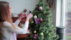 Two cute young girls decorating the Christmas tree Stock Footage