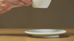 A Man Puts a Cup on a Saucer Stock Footage