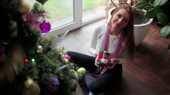 Pretty girl shows a Christmas toy on the camera Stock Footage