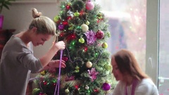 Cute girl take dog on hands near Christmas tree Stock Footage