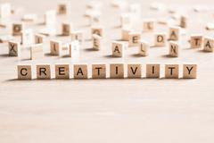 Wooden elements with word creativity Stock Photos