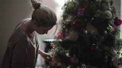Cute blonde decorating the Christmas tree Stock Footage
