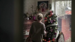 Two sisters decorates Christmas tree in the home Stock Footage