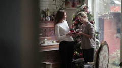 Two sisters recreate near Christmas tree Stock Footage