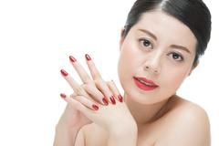 Sexy glamour woman red lipstick with red nail polish finger Stock Photos