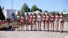 Defile of young women in bikinis in the aquapark Stock Footage