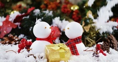 Two snowman with fake snow Stock Footage