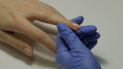 Manicurist makes girl french manicure Stock Footage