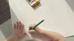 Girl draws line top view Stock Footage