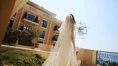 Elegant bride walks around the balcony over the sea Stock Footage