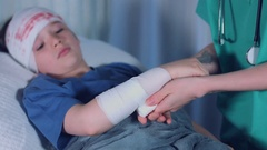 4k Hospital Shot of a Sick Child, Doctor Applying Bandage on Injured Arm Stock Footage