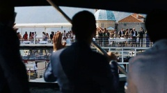 People wave to each other standing on different yachts Stock Footage