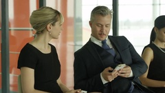 4K Traveling business group in airport building, man talking on cell phone Stock Footage