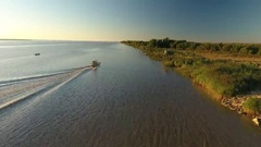 Aerial view of a fishing boat on the Gironde estuary at sunset Stock Footage