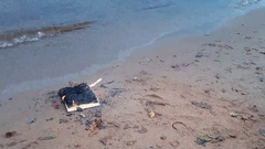 Burning book on the sand at coast Stock Footage