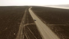 AERIAL: Car in desert on earth road (Peru, South america) Stock Footage
