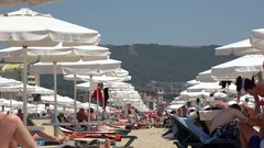 Tourist famous vacation resort with umbrellas and chairs Stock Footage