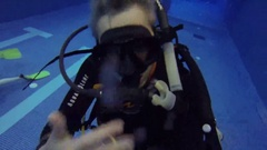Instructor and divers in pool in suits Aqualung Stock Footage