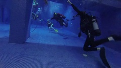 Instructor, divers in pool in suits Aqualung in Moscow Stock Footage