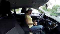 Happy woman driver sits in car and haves fun at summer day Stock Footage