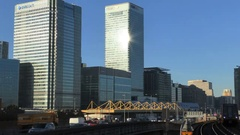Dynamic Sun Bright Canary Wharf Banks Architecture and Traffic Stock Footage