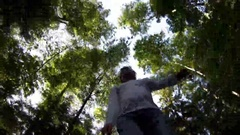 Man and woman roller skate in forest, man makes selfie with stick Stock Footage